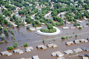 """Minot, N.D., flooded from the Souris River in June 2011"" by Clay Church of the U.S. Army Corps of Engineers"